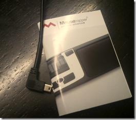 Guia rápido de instruções e cabo USB de ligação